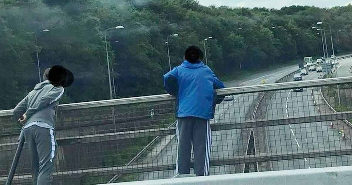 Teenage yobs hurl objects off bridge onto busy dual carriageway below