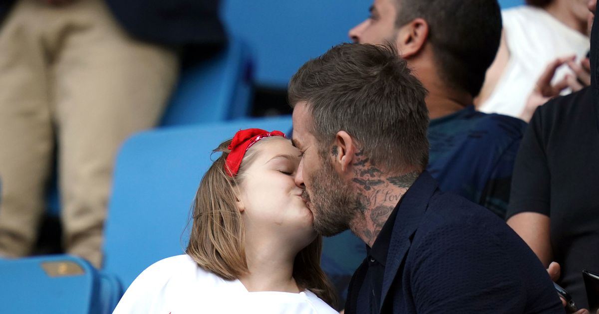 David Beckham risks wrath of trolls by kissing daughter Harper at England match