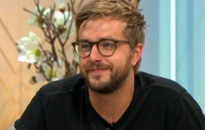 Iain Stirling downs beer from his Love Island bottle at boozy afterparty