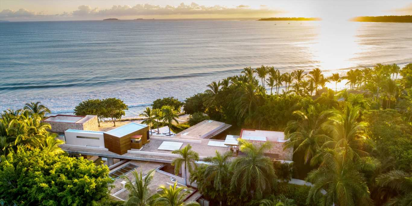 A former Apple and Bridgewater exec is selling his Mexico mansion for $20 million. Take a look inside the 7-bedroom home, which comes with 206 feet of private beach and multiple pools.
