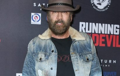 Nicolas Cage arrives unrecognizable at 'Running with the Devil' film premiere