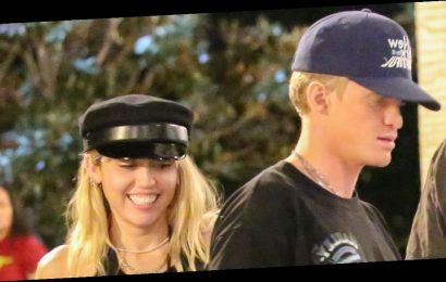 Miley Cyrus and Cody Simpson pack on the PDA on Halloween-themed date night