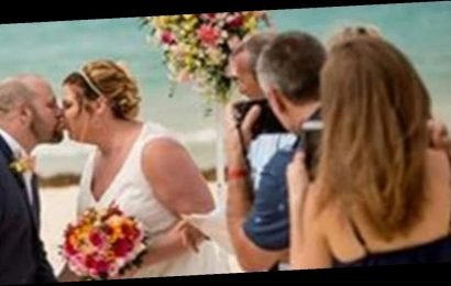 Disapproving swimmer ruins couple's beach wedding by photobombing special moment