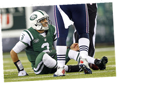 10 Greatest Thanksgiving Football Moments, From Mark Sanchez's Butt Fumble to Peyton Manning's Huge Day (Photos)