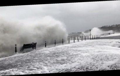 Swimmer filmed braving bumpy seas in hair-raising clip as 80mph winds smash UK