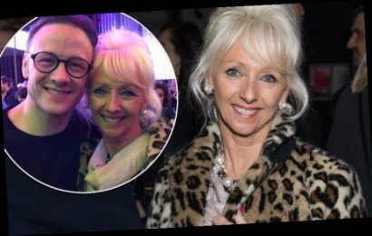 Debbie McGee stands out in leopard print as she supports Strictly partner Kevin Clifton