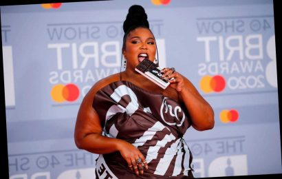 Lizzo Hits 2020 Brit Awards Red Carpet Dipped In Chocolate Bar Gown