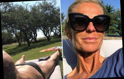 Ulrika Johnsson shows off incredible tan as she sunbathes in a bikini