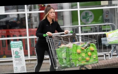 Geordie Shore star Holly Hagan wears black gym gear and flashes engagement ring as she does food shop