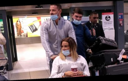Katie Price returns to UK as man arrested after 'black face video of son Harvey'