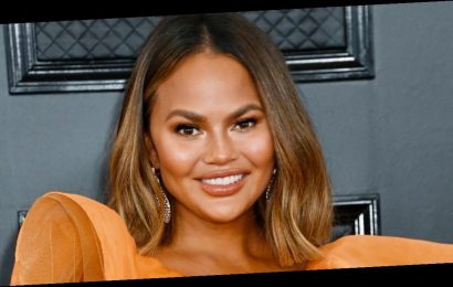 Chrissy Teigen shows off bright purple hair in amazing beauty transformation