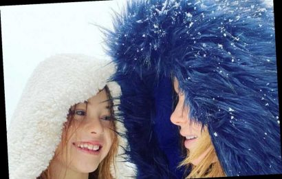 Amanda Holden poses with rarely seen daughter Hollie as they play in the snow