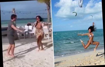 Nicole Scherzinger dances on the beach with boyfriend Thom Evans as she escapes on lavish island holiday