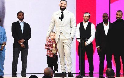 Drake Has Dinner on 50-Yard Line of Stadium To Celebrate Artist of the Decade Award