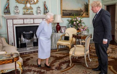 The Queen has a photo of Meghan and Harry on display at Buckingham Palace