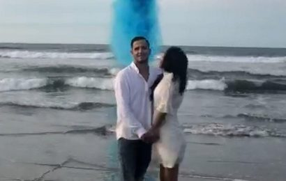Couple overjoyed by gender reveal as plane douses 420L of coloured water on them