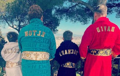 Elton John matches with husband and kids in monogrammed Versace robes
